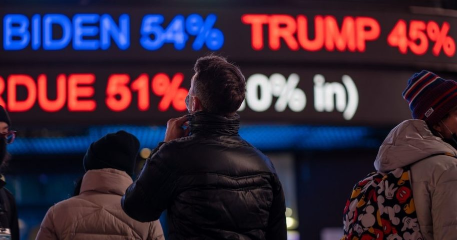 People gather in Times Square in New York City as they await election results on Tuesday.