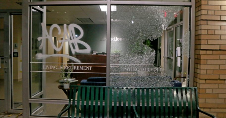 Shattered glass on a storefront and an anti-police acronym mark the latest round of rioting in Portland, Oregon.