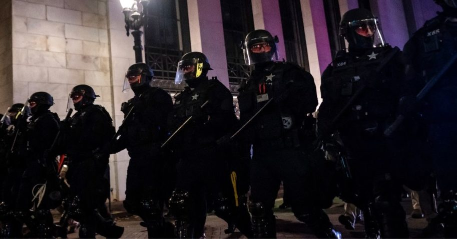 Portland police disperse a crowd of protesters on Nov. 4, 2020, in Portland, Oregon.