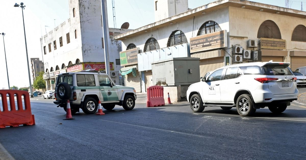 Saudi police close a street leading to a non-Muslim cemetery in the Saudi city of Jeddah where a bomb struck a World War I commemoration attended by European diplomats on Nov. 11, 2020, leaving several people wounded.