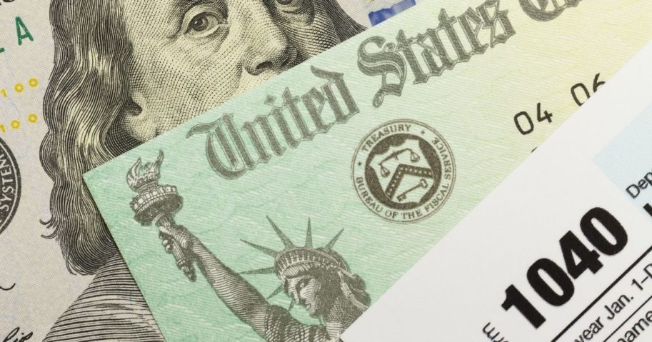 Tax documents appear in the above stock image.