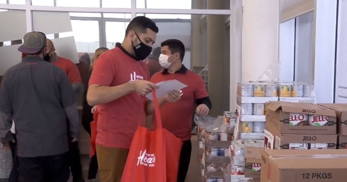 Volunteers help pack meal kits for veterans that were given out on Tuesday in Salt Lake City, Utah.