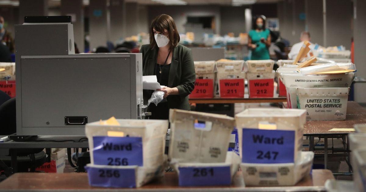 Workers count absentee ballots on Nov. 4, 2020, in Milwaukee, Wisconsin.