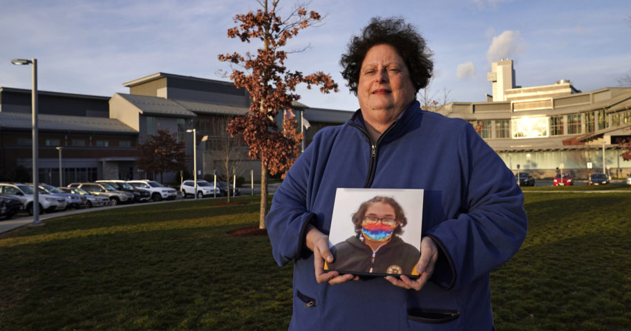 Laura Dilts, of Barre, Massachusetts, holds a photograph of her 16-year-old son outside the Worcester Recovery Center, where he is a resident patient receiving assistance for his mental health, on Nov. 23, 2020, in Worcester, Massachusetts.