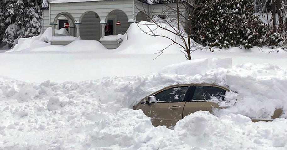 This photo shows a car in Owego, New York, from which a New York State Police sergeant rescued Kevin Kresen, 58, who was stranded for 10 hours, covered by nearly 4 feet of snow thrown by a plow.