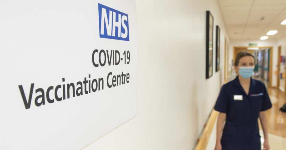 Signs for the COVID-19 Vaccination Centre are seen at the Royal Free Hospital in London on Dec. 7, 2020.