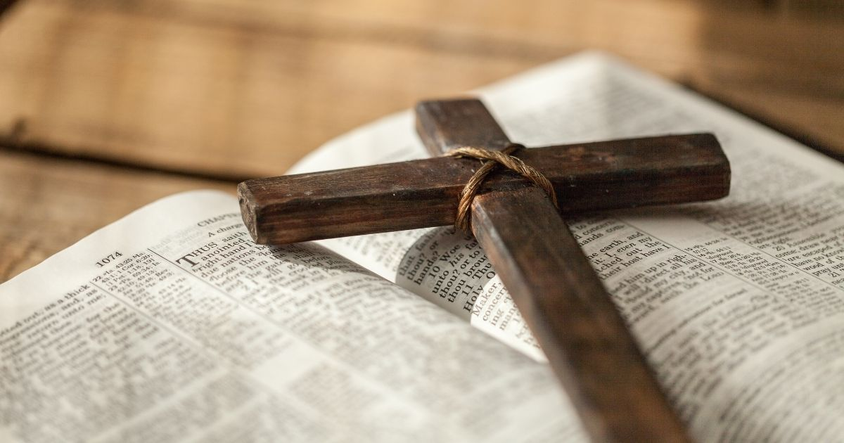 A Bible with a cross on it is pictured in the stock image above.