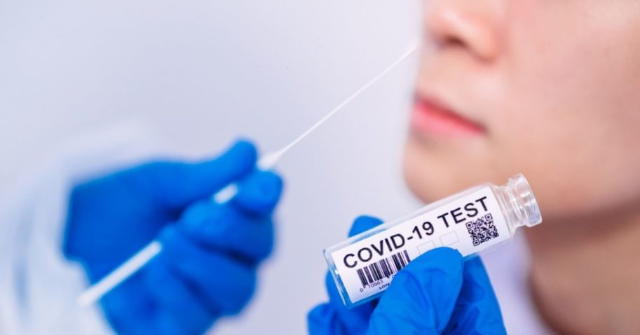 The stock image above shows a doctor holding a kit for the coronavirus test.