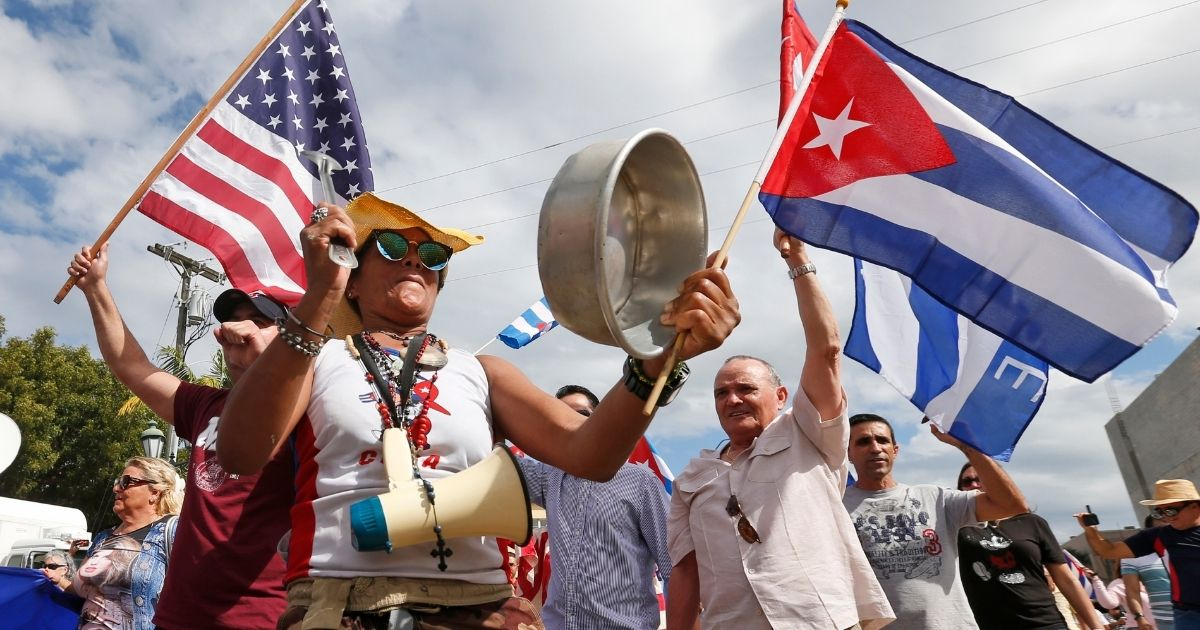 Banging pots and pans and waving Cuban and American flags, members of the Cuban community react to the death of Fidel Castro on Nov. 26, 2016, in the Little Havana area in Miami.