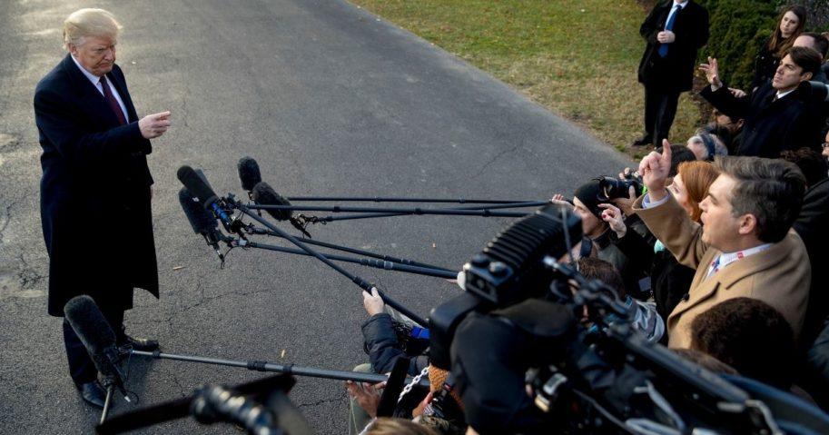 President Donald Trump takes a question from CNN reporter Jim Acosta, right, before boarding Marine One on the South Lawn of the White House in Washington on Nov. 20, 2018.