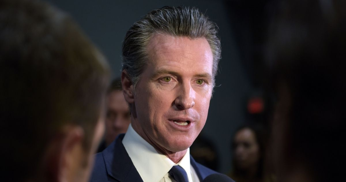 California Gov. Gavin Newsom speaks to the press in the spin room after the sixth Democratic primary debate of the 2020 presidential campaign season in Los Angeles on Dec. 19, 2019.