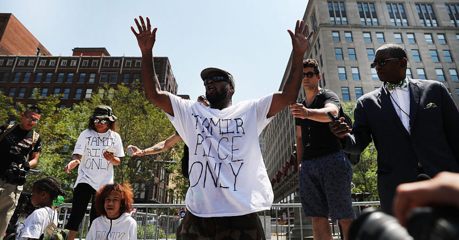 A man speaks out against the shooting of 12 year-old Tamir Rice by police near the site of the Republican National Convention in downtown Cleveland on the second day of the convention on July 19, 2016.