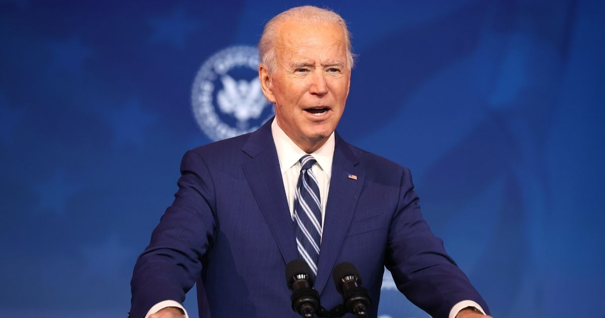Joe Biden speaks as he announces retired U.S. Army Gen. Lloyd Austin as his choice to be secretary of the Department of Defense at the Queen Theatre on Wednesday in Wilmington, Delaware.