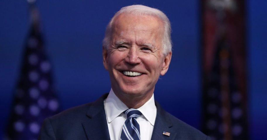 Presumptive President-elect Joe Biden smiles during a media briefing Nov. 10 at the Queen Theater in Wilmington, Delaware.