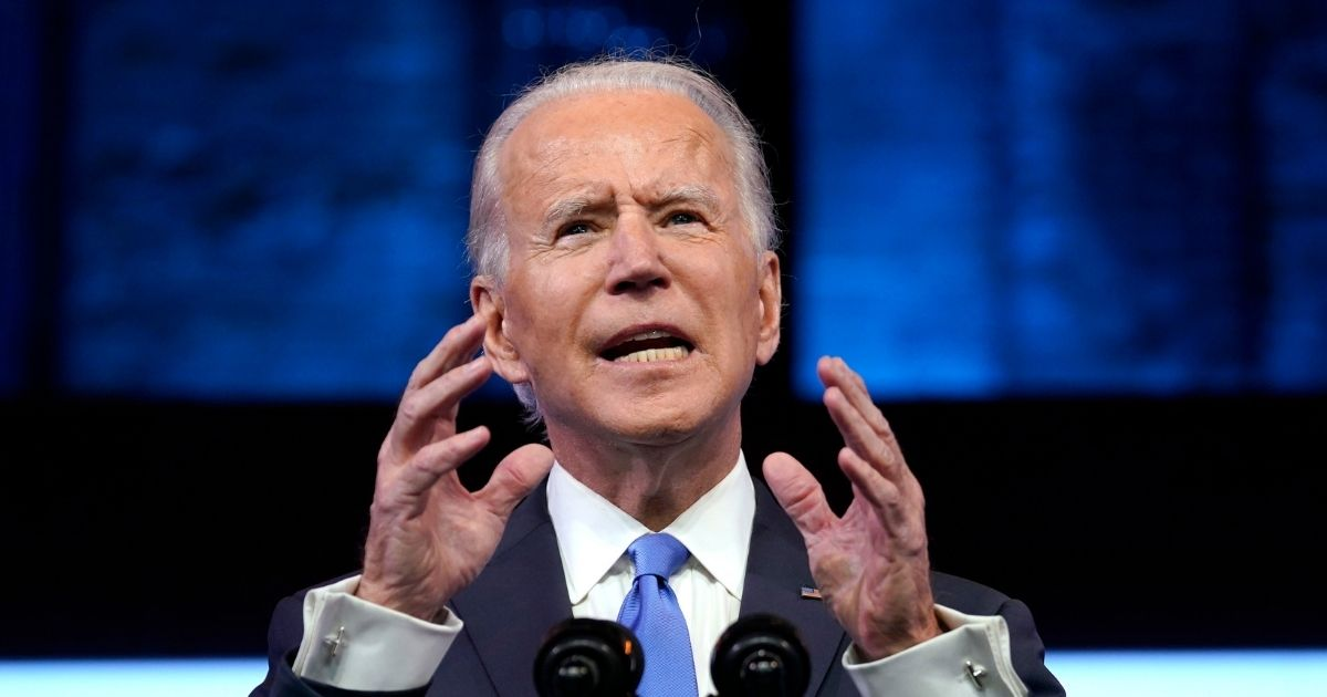 Presumptive president-elect Joe Biden speaks about the Electoral College vote certification process at The Queen Theatre in Wilmington, Delaware, on Monday.