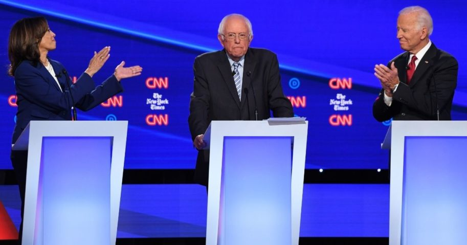 California Sen. Kamala Harris, left, Vermont Sen. Bernie Sanders and former Vice President Joe Biden, right, participate in the fourth Democratic primary debate of the 2020 presidential campaign season at Otterbein University in Westerville, Ohio, on Oct. 15, 2019.