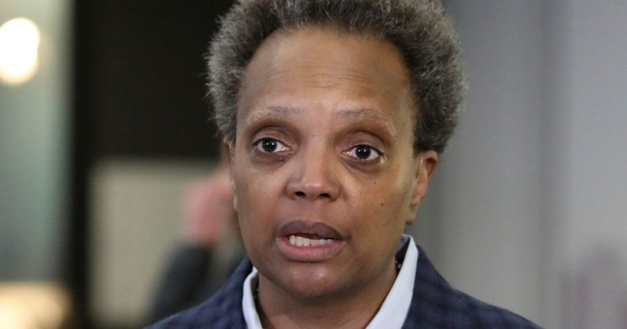 Chicago Mayor Lori Lightfoot speaks to reporters at the city's O'Hare International Airport on March 15.