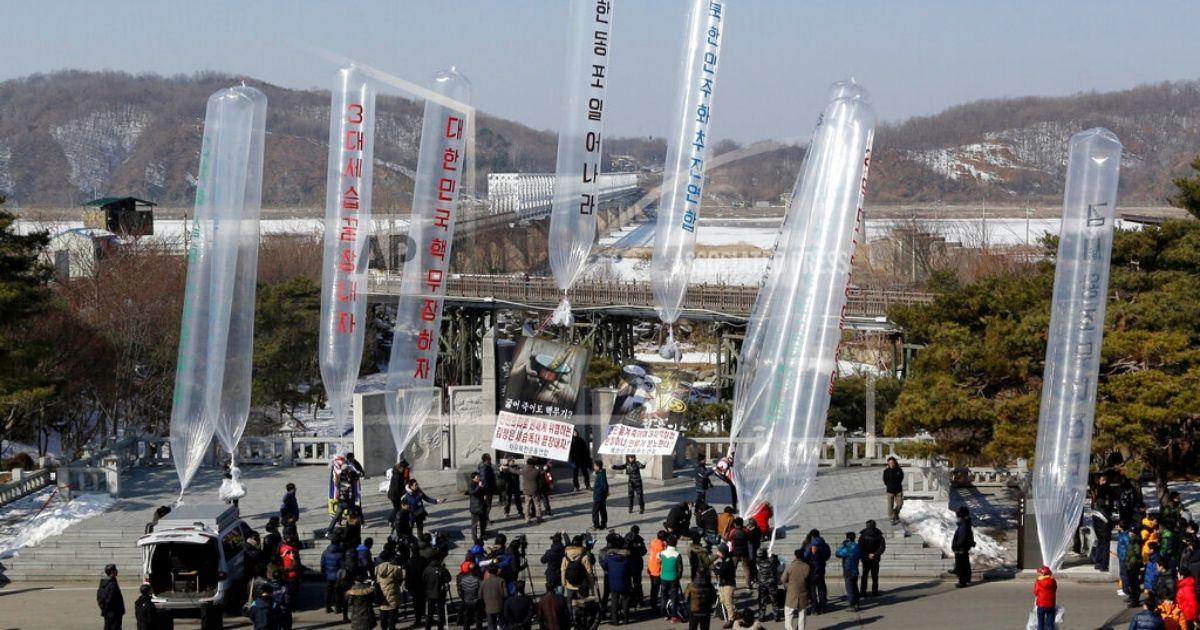 North Korean defectors and South Korean activists prepare to launch ten helium balloons carrying leaflets against North Korean leader Kim Jong Un.