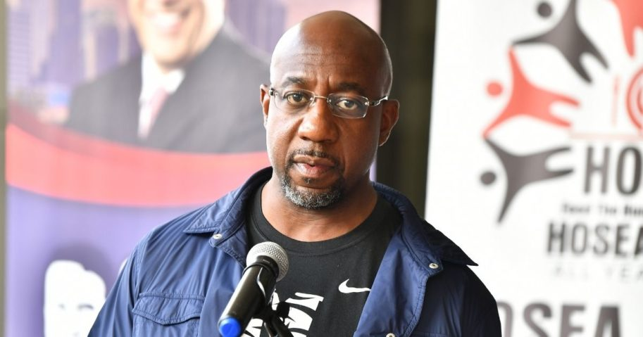Democratic Senate candidate the Rev. Raphael Warnock speaks onstage during the Hosea Helps Thanksgiving Dinner Drive Thru at Georgia World Congress Center in Atlanta on Thursday.