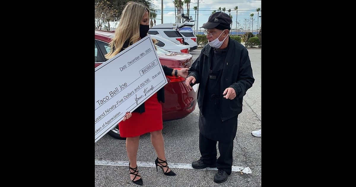 Tricia Phillippi present Taco Bell Joe with a check for over $6,000 after he won a local online popularity contest for his upbeat demeanor and kindness.