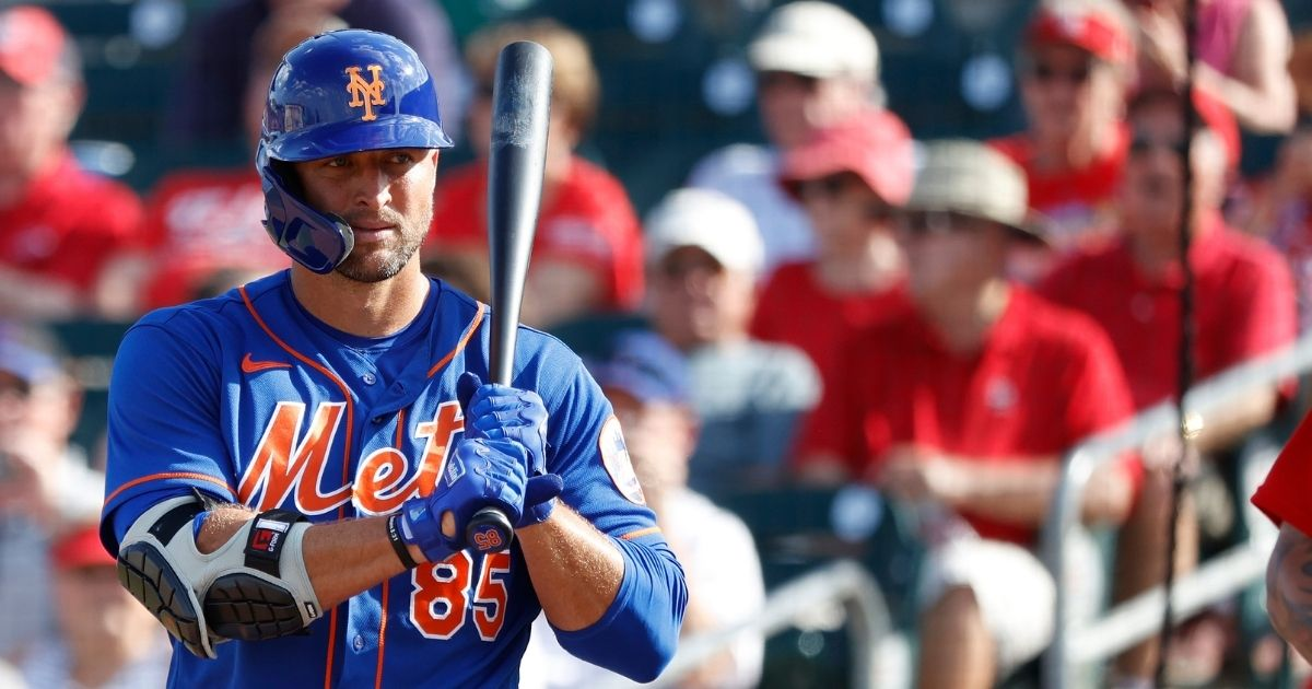 Tim Tebow #85 of the New York Mets looks on before stepping to the plate to bat against the St Louis Cardinals during a Grapefruit League spring training game at Roger Dean Stadium on March 5 in Jupiter, Florida.