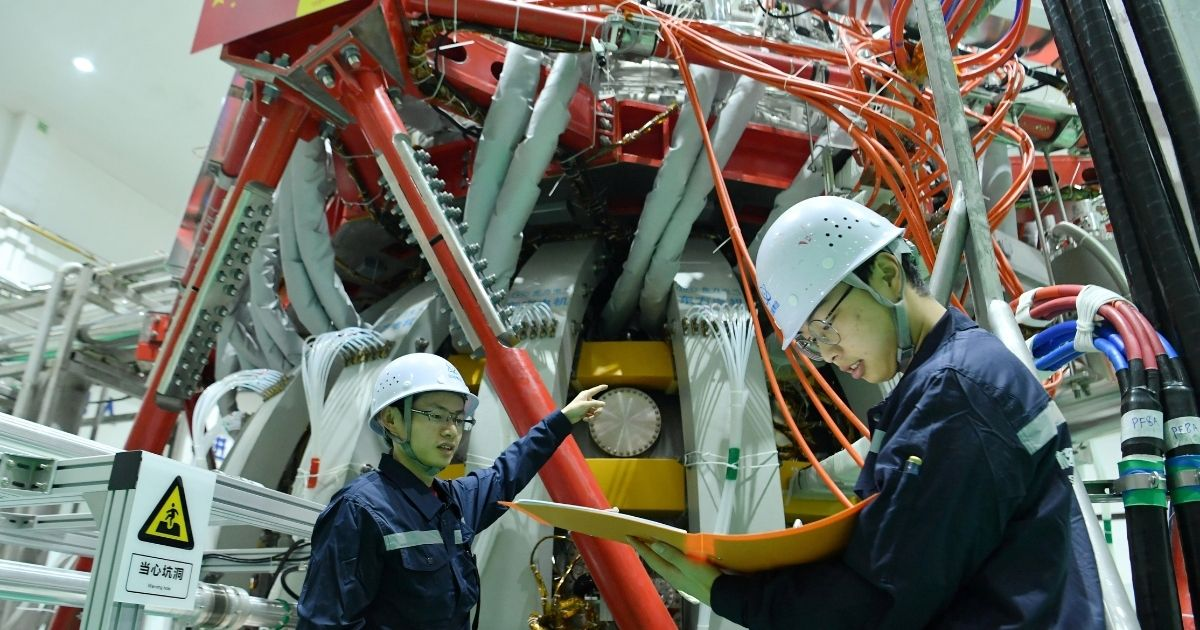 """Technical personnel check China's HL-2M nuclear fusion device, known as the new generation of """"artificial sun"""", at a research laboratory in Chengdu, in the country's Sichuan province."""