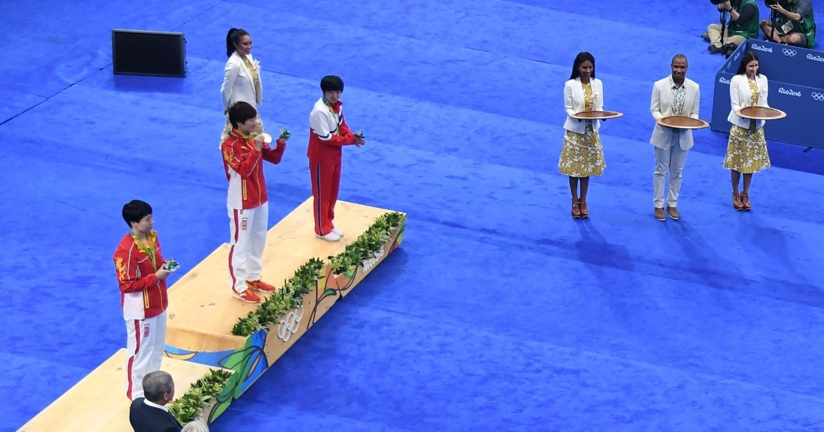China's Ding Ning, middle, compatriot Li Xiaoxia, left, and North Korea's Kim Song I are awarded the gold, silver and bronze medals, respectively, in table tennis at the Summer Olympics in Rio de Janeiro on Aug. 10, 2016. Breakdancing, called 'breaking,' will begin as an OIympic sport in 2024.