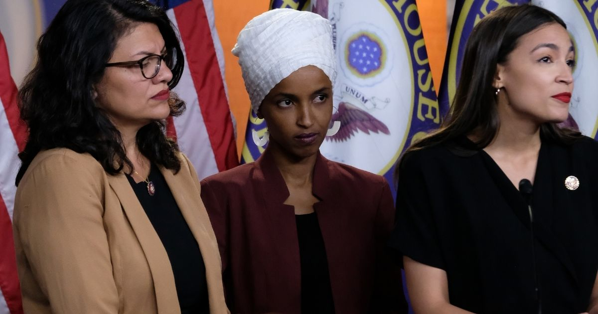 From left, U.S. Reps. Rashida Tlaib, Ilhan Omar and Alexandria Ocasio-Cortez attend a news conference at the U.S. Capitol on July 15, 2019.