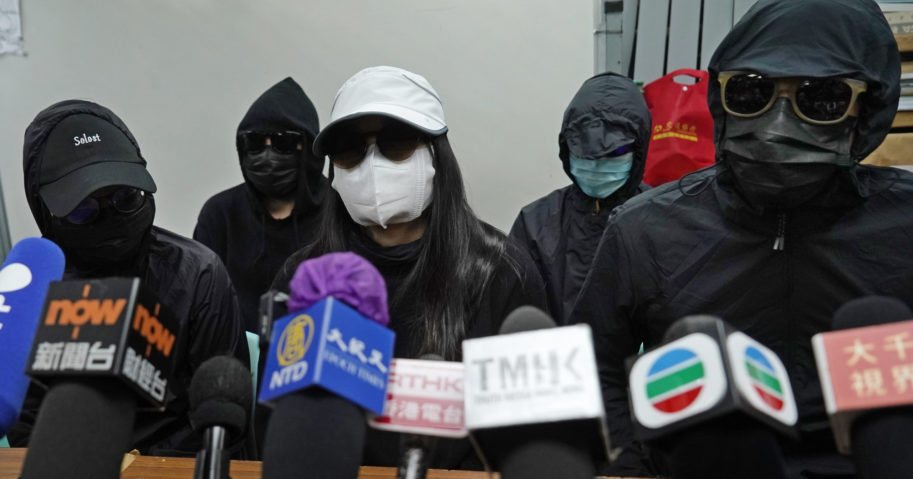 Relatives of 12 Hong Kong activists detained at sea by Chinese authorities attend a news conference in Hong Kong on Dec. 28, 2020.