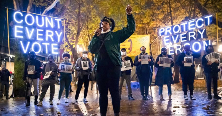 In this Nov. 4, 2020, file photo, Travonna Thompson-Wiley with the Black Action Coalition speaks at a rally and march in Occidental Park in Seattle. The coalition demanded, among other things, the elimination of the Electoral College.