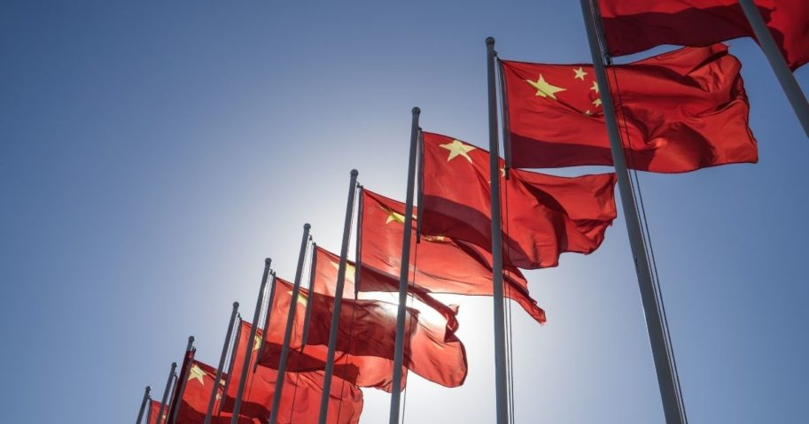 Chinese flags fly in the above stock image.
