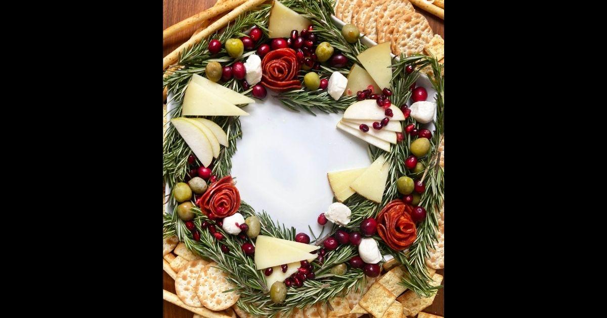 A charcuterie board arranged to look like a Christmas wreath.