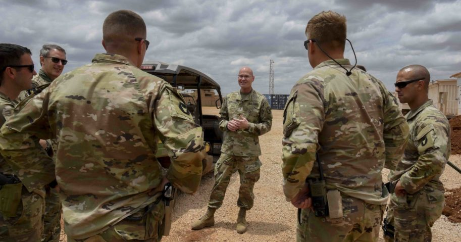 U.S. Army Brig. Gen. Damian T. Donahoe, center, talks with service members on Sept. 5, 2020, in Somalia.