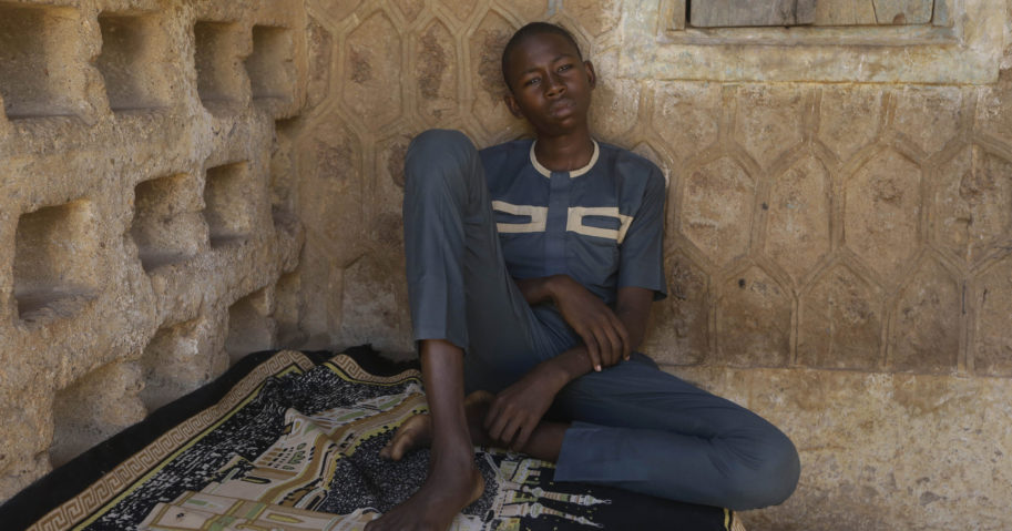 Usama Aminu, a 17-year-old student of the Government Science Secondary School who escaped from Boko Haram insurgents, sits for an interview with The Associated Press in Kankara, Nigeria, on Dec. 16, 2020.