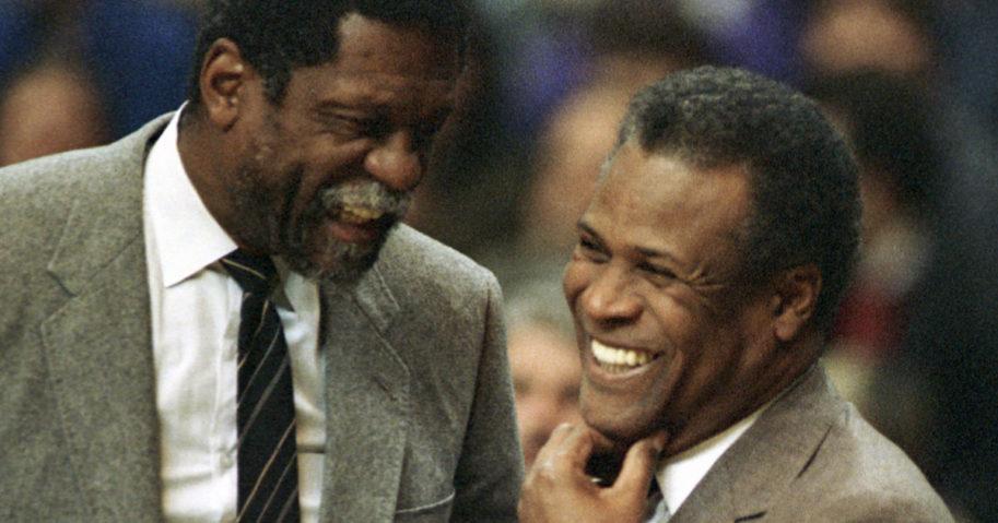 In this Jan. 15, 1988, file photo, former Boston Celtics teammates Bill Russell, Sacramento Kings coach, left, and K.C. Jones, Celtics coach, meet before the start of the Kings-Celtics NBA basketball game at the Boston Garden in Boston.