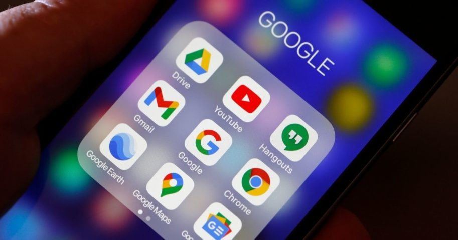 The logos of Google applications are displayed on the screen of an iPhone on Dec. 14, 2020, in Paris.