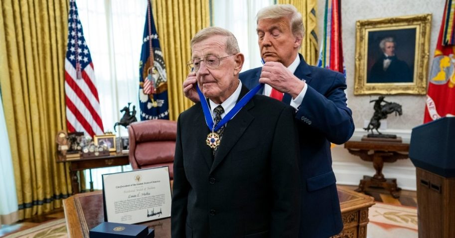 President Donald Trump presents the Medal of Freedom to former college football coach Lou Holtz in the Oval Office of the White House on Dec. 3, 2020, in Washington, D.C.