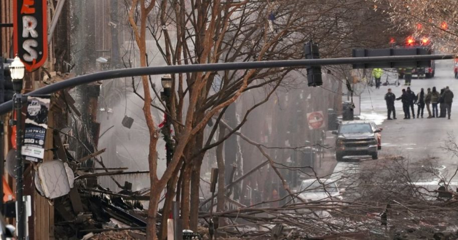 Emergency personnel work at the scene of an explosion in downtown Nashville, Tennessee, on Friday. Buildings shook in the immediate area and beyond after a loud boom was heard early Christmas morning.