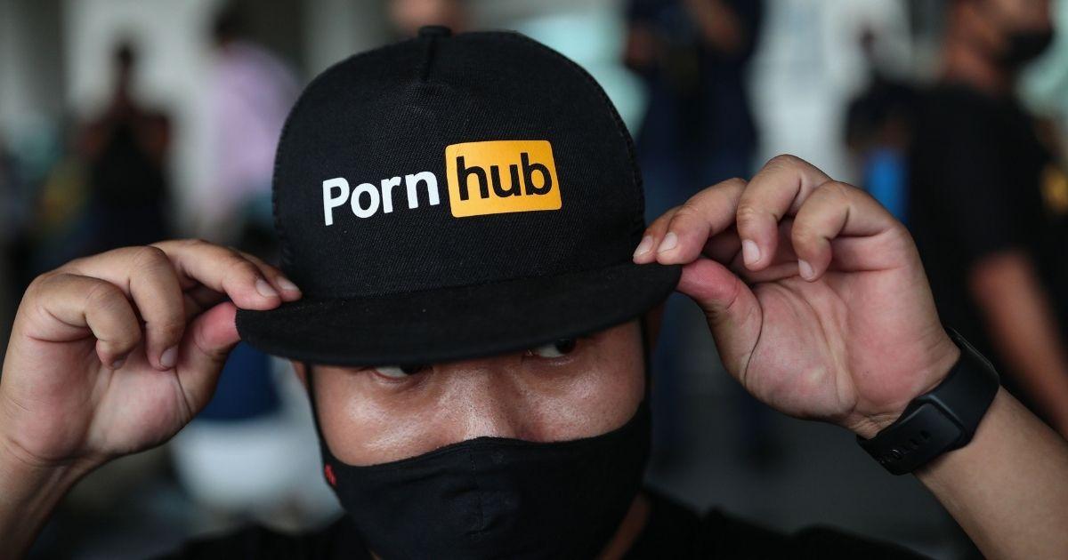 A man wears a cap with the Pornhub logo in Bangkok on Nov. 3, 2020.