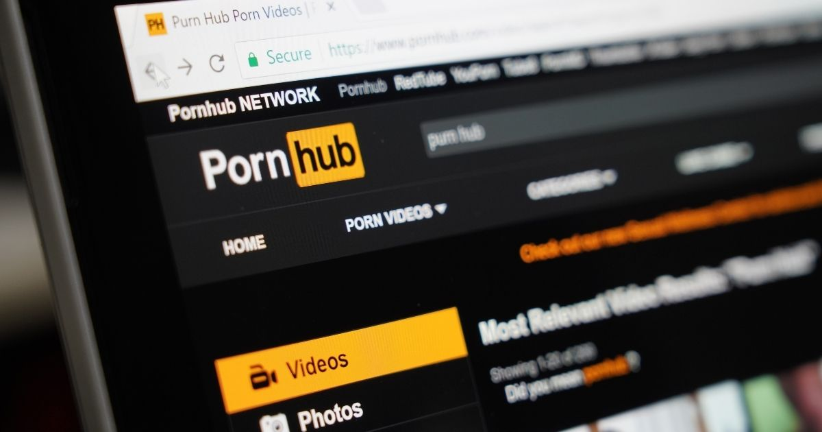 The website Pornhub is displayed on a computer screen in the above stock image.