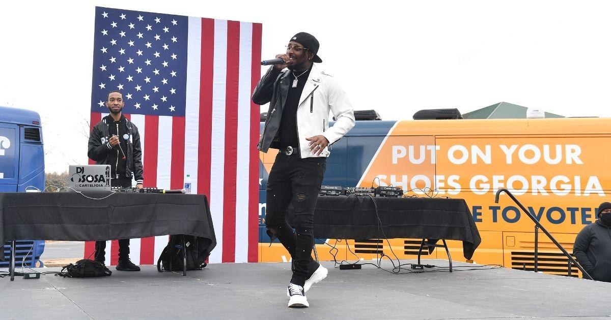 Rapper BRS Kash performs onstage
