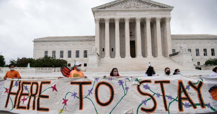 Activists supporting the Deferred Action for Childhood Arrivals program hold a banner in front of the US Supreme Court in Washington, D.C., on June 18, 2020.