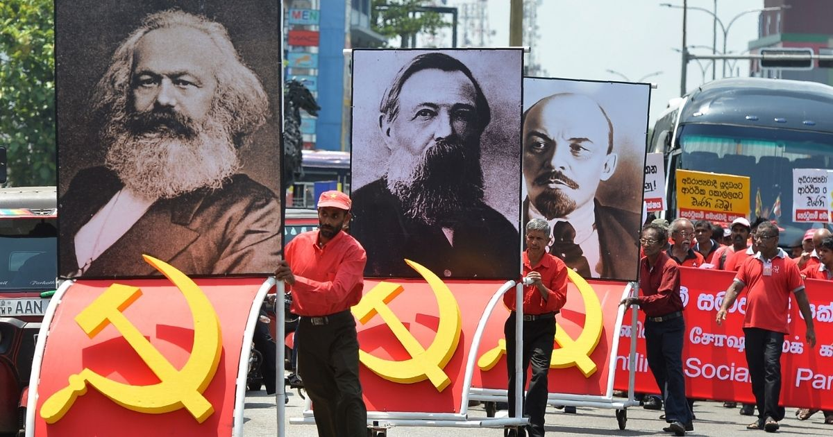 Supporters of the Frontline Socialist Party display placards with images of Karl Marx, left, Friedrich Engels, center, and Vladimir Lenin as they take part on a May Day rally in Colombo on May 1, 2018.