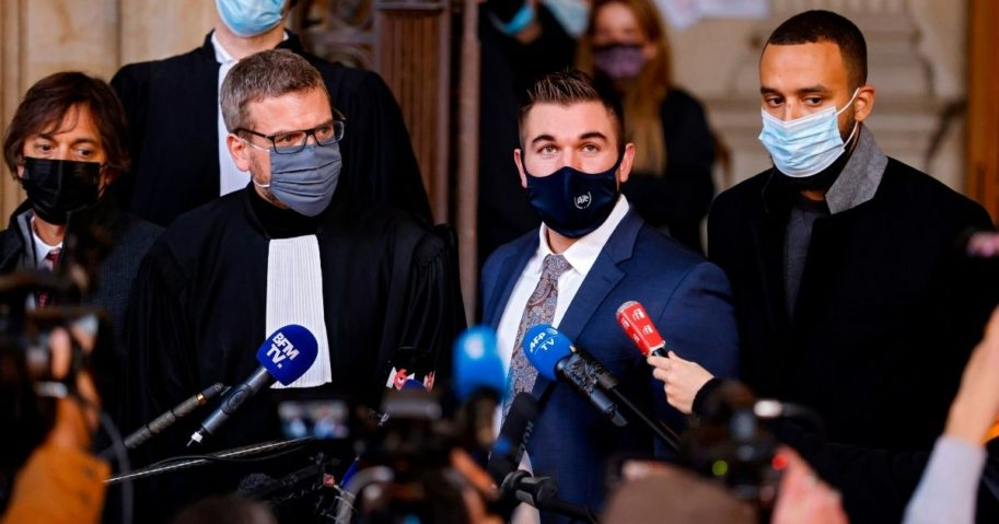 From left to right, French-American professor Mark Magoolian, French lawyer Thibault de Montbrial, US former serviceman Alek Skarlatos and US national Anthony Sadler speak to the media at a courthouse in Paris on Nov. 20, 2020, on the second day of the trial of Ayoub El Khazzani, a Moroccan man whose attempted terror attack on a train in 2015 was foiled by passengers.