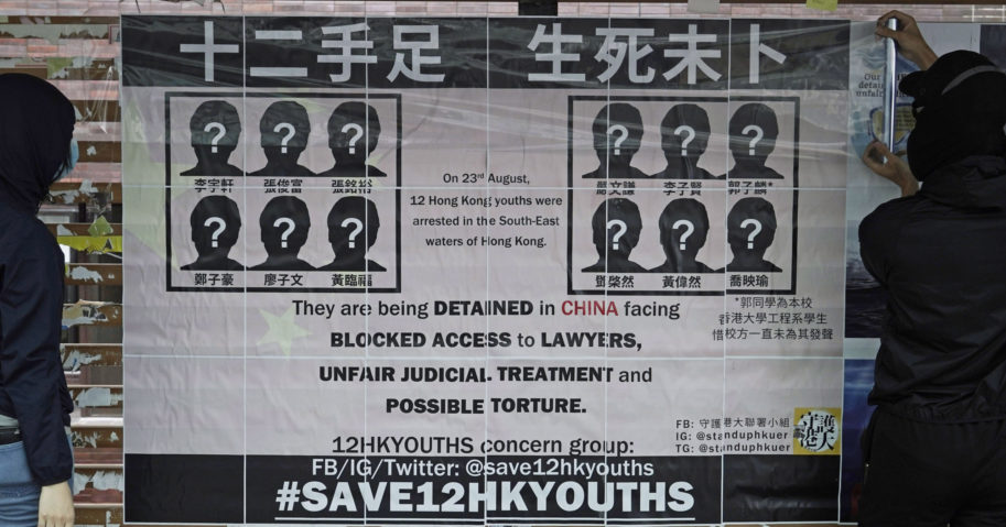 University students put up posters demanding the release of 12 Hong Kong pro-democracy activists detained at sea by Chinese authorities on Sept. 29, 2020.