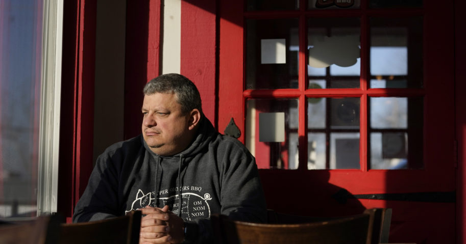 Jeff Fitter, owner of Super Smokers BBQ, poses for a photo inside his restaurant on Jan. 28, 2021, in Eureka, Missouri. Fitter says his profits were down by about half last year due to the closures and capacity limits imposed by St. Louis County.