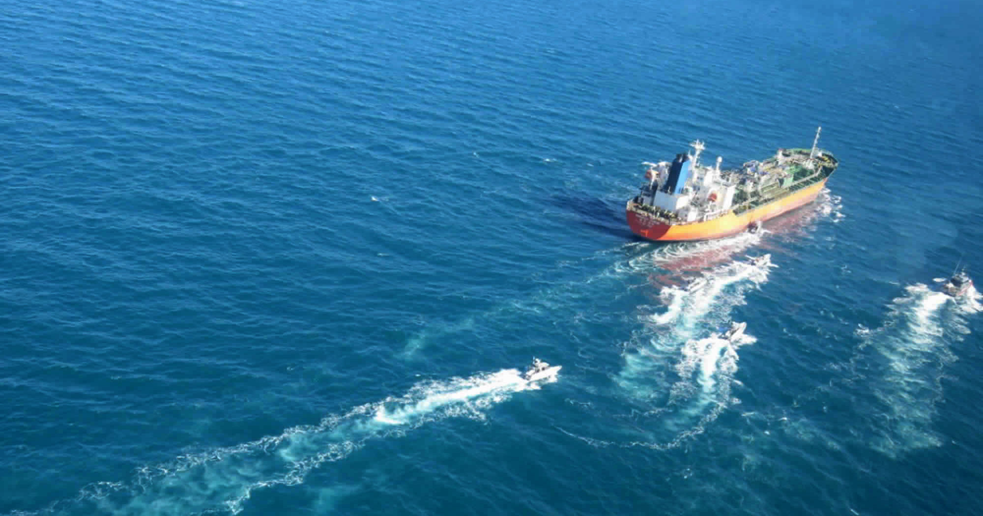 In this photo released on Jan. 4, 2021, the MT Hankuk Chemi, a South Korean-flagged tanker, is escorted by Iranian Revolutionary Guard boats on the Persian Gulf.