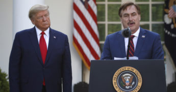 MyPillow CEO Mike Lindell speaks as President Donald Trump listens during a briefing in the Rose Garden of the White House in Washington, D.C., on March 30, 2020.