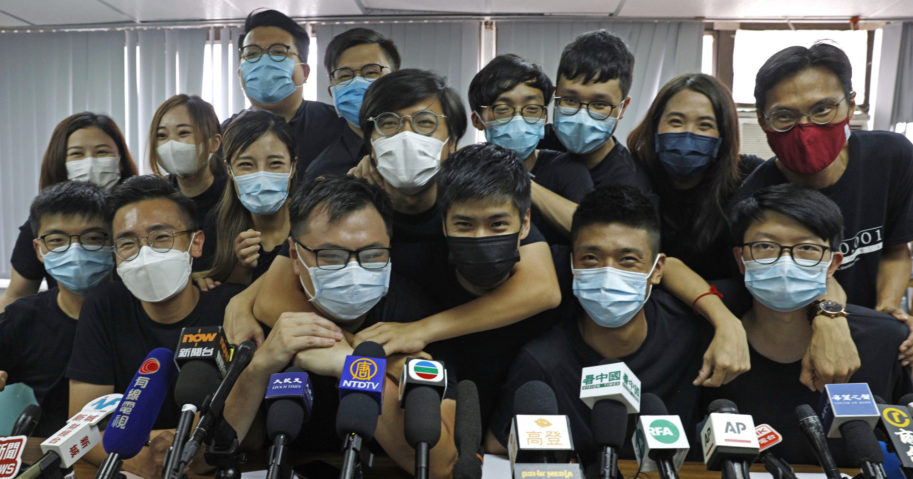 Pro-democracy activists who were elected in unofficial pro-democracy primaries attend a news conference in Hong Kong on July 15, 2020.