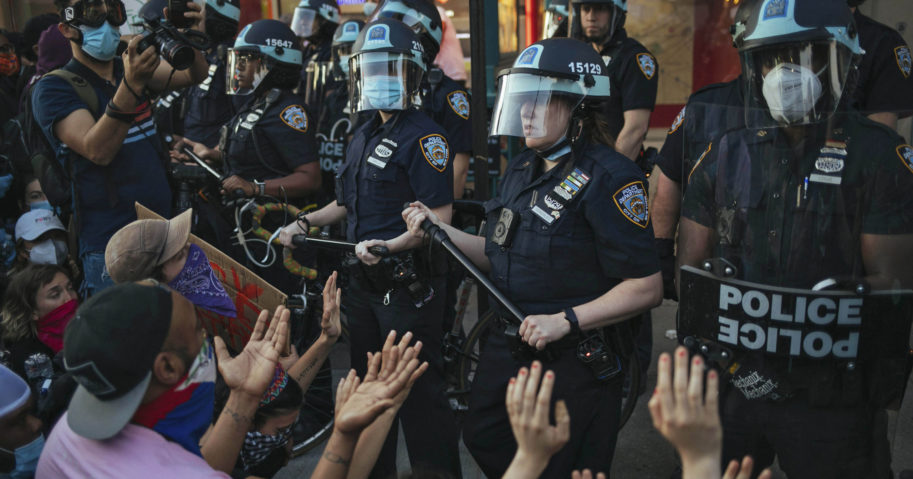 New York City police face off with activists during a protest in the Brooklyn borough of New York on May 31, 2020.
